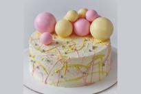 Торт С розовыми и желтыми шоколадными шарами SWEETMARIN
